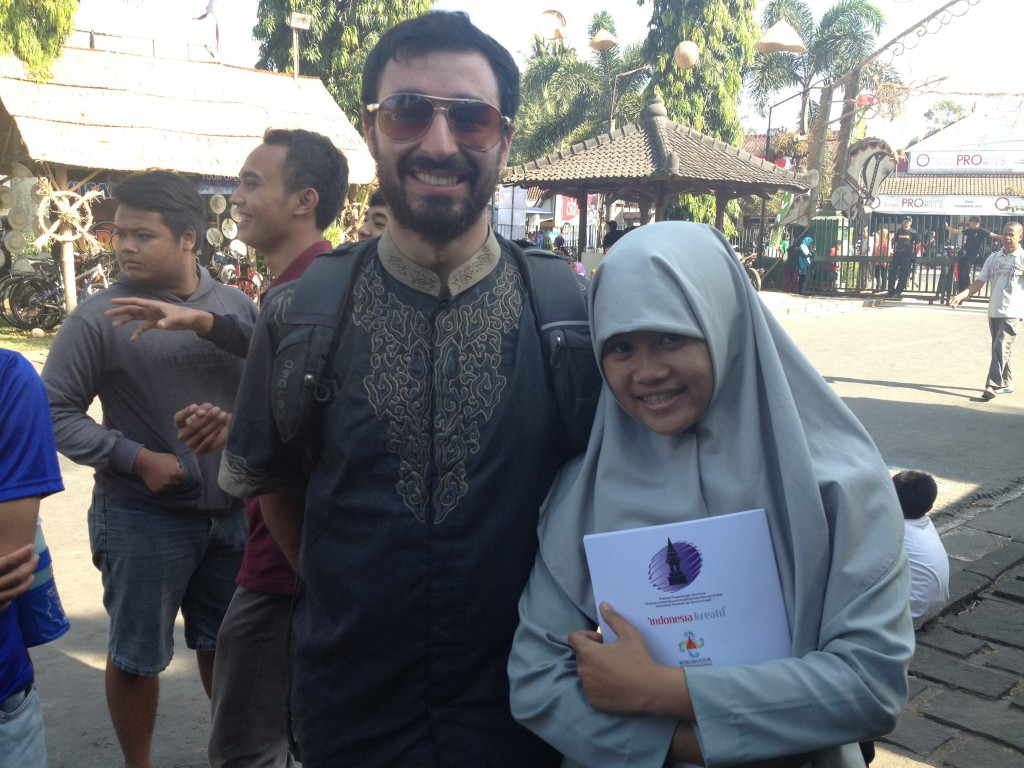 Max obliging sweet Indonesian student requesting his photo at Borobudor.